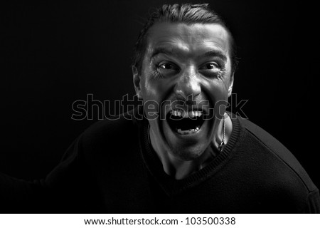 Black and white portrait of angry man shouting at camera