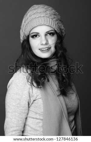 Black and White portrait of beautiful girl dressed for winter