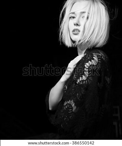 Black and white portrait of  blonde with short hair on a black background - stock photo