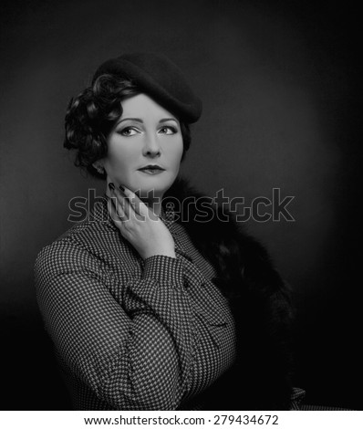 Black and white portrait of  charming woman in elegant retro image. - stock photo