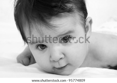 black and white portrait of cute baby close-up - stock photo