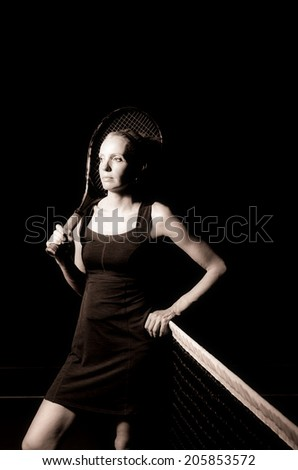 Black and white portrait of female tennis player - stock photo