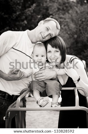 black and white portrait of happy family with baby - stock photo