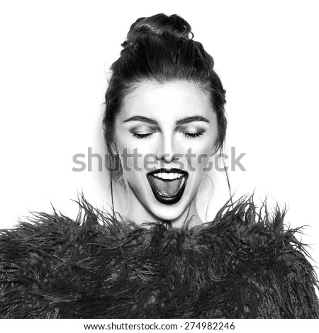 Black and white portrait of young beautiful laughing girl.Beautiful woman face.Perfect toothy smile.Red lips,skin,teeth.Isolated on white background. Studio shot .Happy positive girl.Fashion clothes. - stock photo