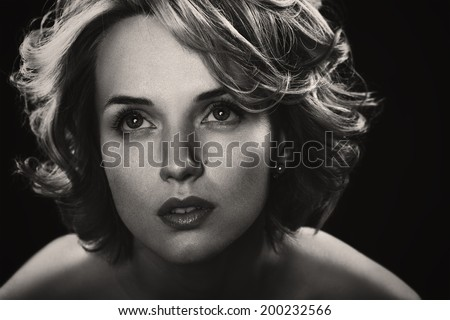 Black and white portrait of young beautiful woman with blond curly hair. studio photoshoot - stock photo