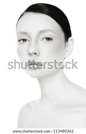 Black and white portrait of young beautiful woman with clear make-up over white background - stock photo