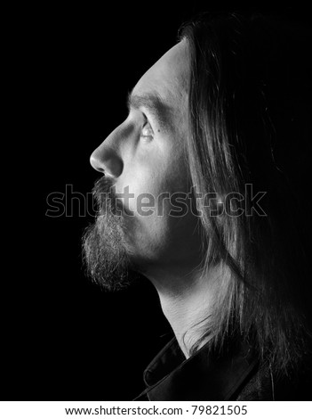black and white profile of bearded man