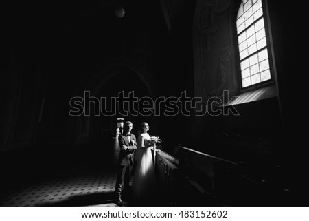Black and white romantic photo of wedding couple in the church