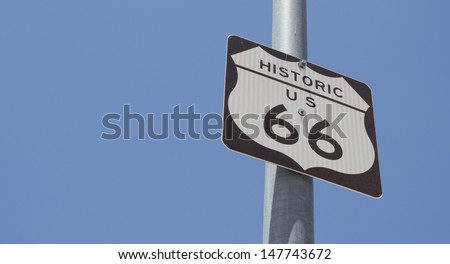 Black and white Route 66 signpost over the blue sky