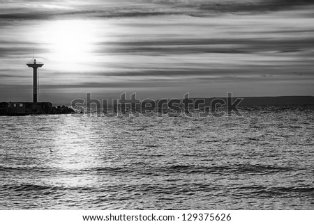 Black and white seascape with lighthouse