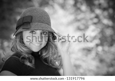 Black and white shoot of woman in the park - stock photo