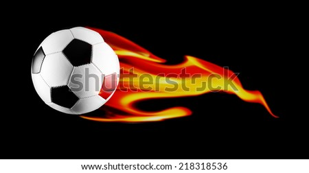 Black and white soccer ball with fire on black background. - stock photo