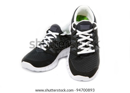 Black and white sport shoes on white background - stock photo