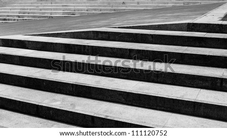 Black and white stone and concrete staircase. - stock photo