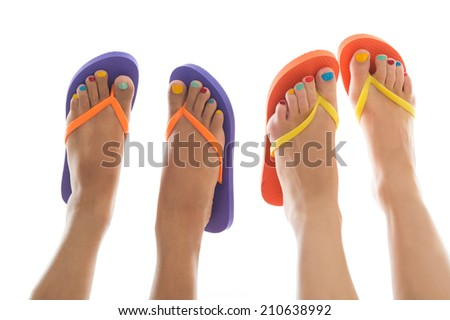 Black and white summer feet with colorful flip flops - stock photo