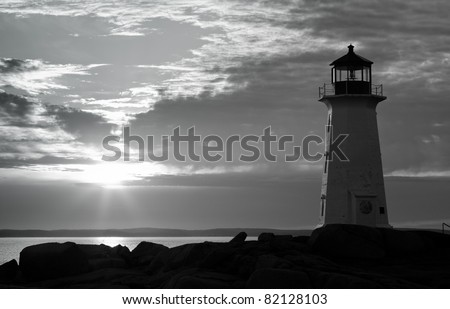 Black and White Sunset at Peggy's Cove Lighthouse - stock photo