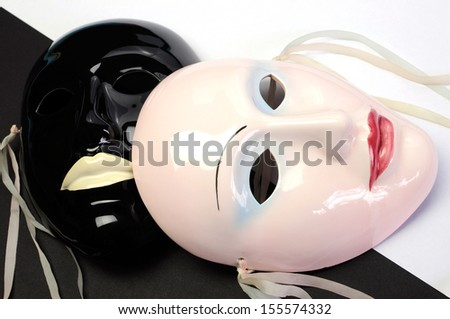 Black and white theme ceramic masks for acting, performance or theater concept. Close up. - stock photo
