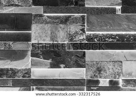 Black and white tone of natural granite stone wall for background texture. - stock photo