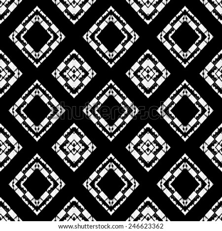 Black and white tones tribal or ethnic background pattern with geometric and abstract symbols motif in hard contrast. - stock photo