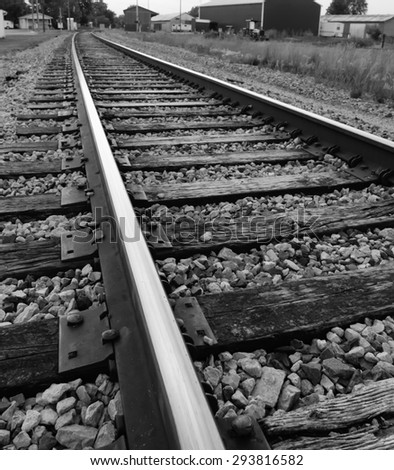 black and white up close view railroad tracks