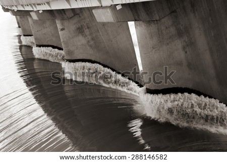 Black and white view from one side of the wall of famous Gariep Dam near Norvalspont in South Africa. - stock photo