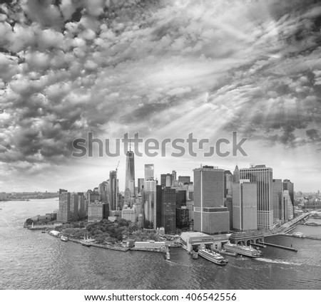 Black and white view of Downtown Manhattan skyline, New York City at sunset. - stock photo