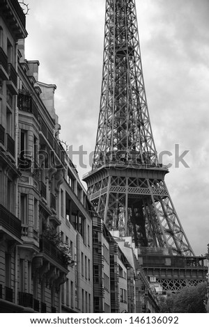 Black and white view of Eiffel Tower with French architecture in Paris France