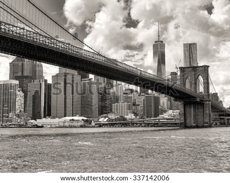 Black and white view of the Brooklyn Bridge and the downtown Manhattan skyline in New York City - stock photo