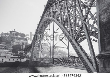 Black and white view of the Luis I bridge over Douro river.