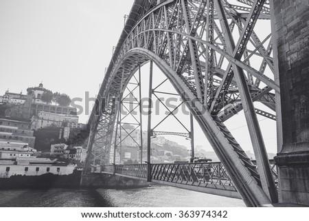 Black and white view of the Luis I bridge over Douro river. - stock photo