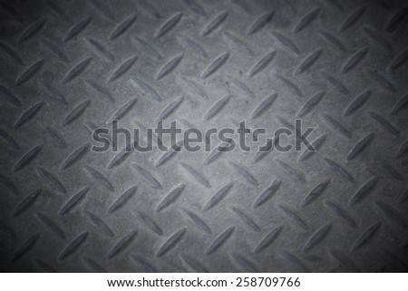 Black and white vintage looking steel plate useful as background - stock photo