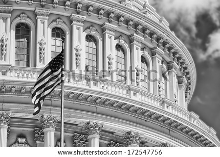 Black and white Washington DC Capitol detail with waving american flag - stock photo