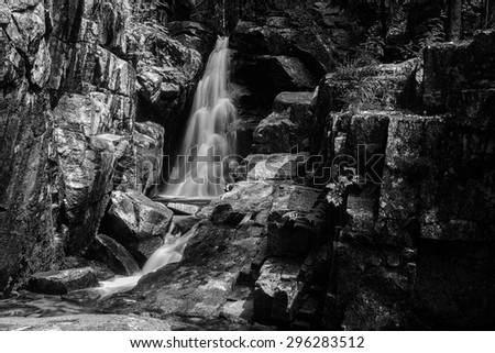 black and white waterfall long time with high contrast  - stock photo