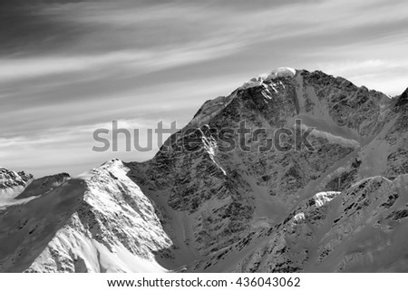 Black and white winter mountains at sun morning. Caucasus Mountains, mt. Donguzorun. View from ski slope Elbrus.