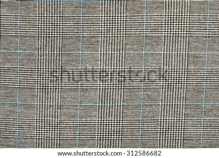 Black and white with blue houndstooth pattern in squares. Black and white wool twill pattern. Woven dogstooth check design as background. - stock photo