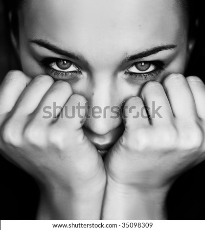 Black and white woman lean on the fists - stock photo