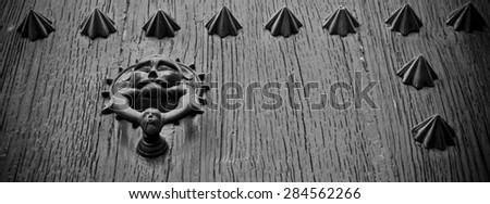 Black and white wooden door knob  - stock photo