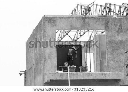Black and white worker working in construction site