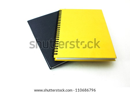 Black and yellow books on white isolated background - stock photo