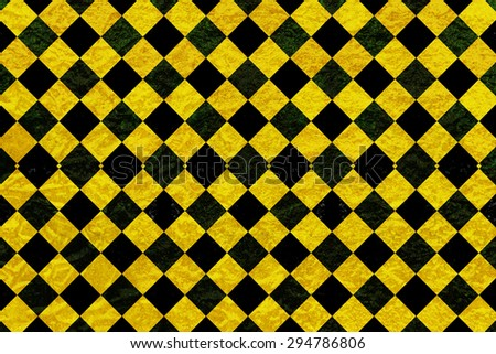 Black and yellow chequered pattern background - stock photo