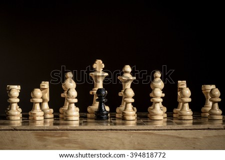 Black and yellow chess pieces on a chess board. - stock photo