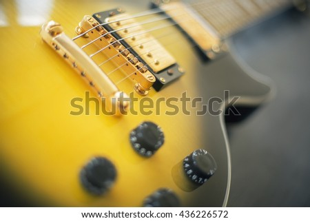 Black and yellow electric guitar - stock photo