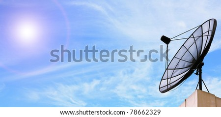 black antenna communication satellite dish over sunny blue sky - stock photo