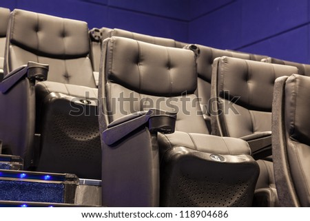 black armchairs in the cinema ordered - stock photo