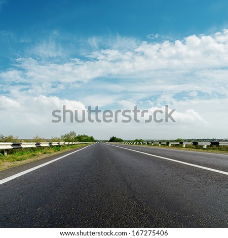 black asphalt road and cloudy horizon