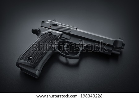 Black automatic gun - stock photo