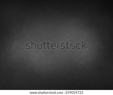 black background with gray center light spot and vignette border with texture - stock photo