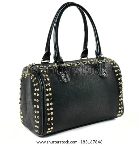 Black Bag punk rock style with gold spikes. - stock photo
