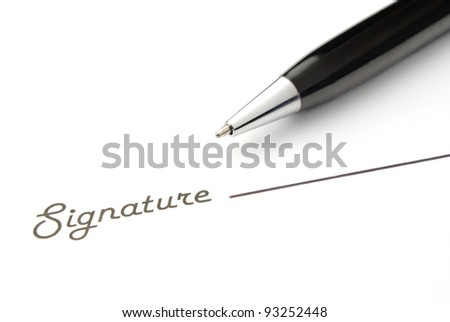 black ballpoint pen and place for the signature - stock photo