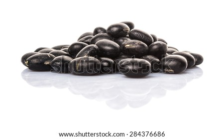 Black beans over white background